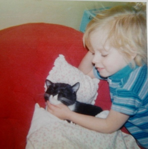 Kristene Perron as a child with cat