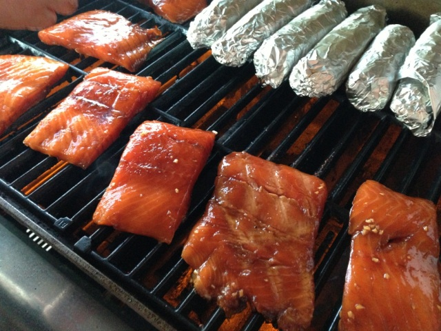 BBQ salmon cooking on the grill