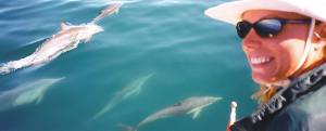 Kristene Perron with dolphins in Baja