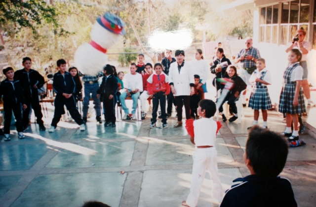 boy hitting a Christmas pinata