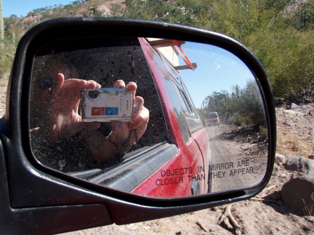 Camera shot into side mirror of truck