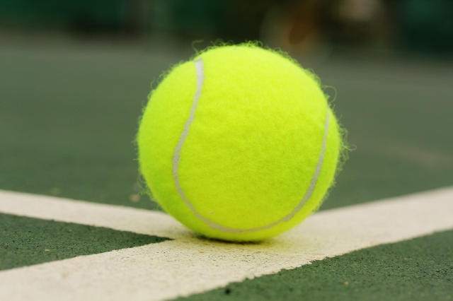tennis-ball-on-surface-of-hard-court-f5